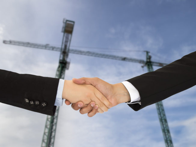 close up of construction deal with handshake