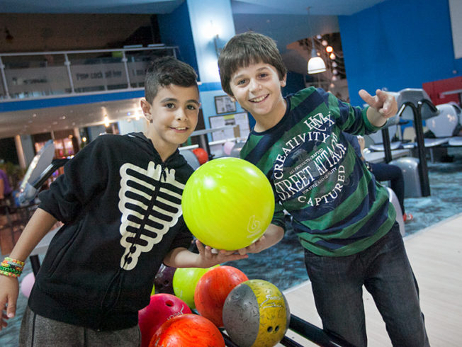 north-cyprus-pink-bowling-day-children-holding-bowling-ball