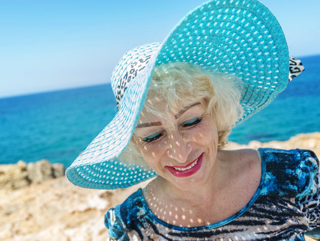 emerald bay in lapta. lady Natalja Jesam in hat before blue azur mediterranean colours