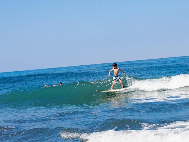 north-cyprus-children-surfing-ocean
