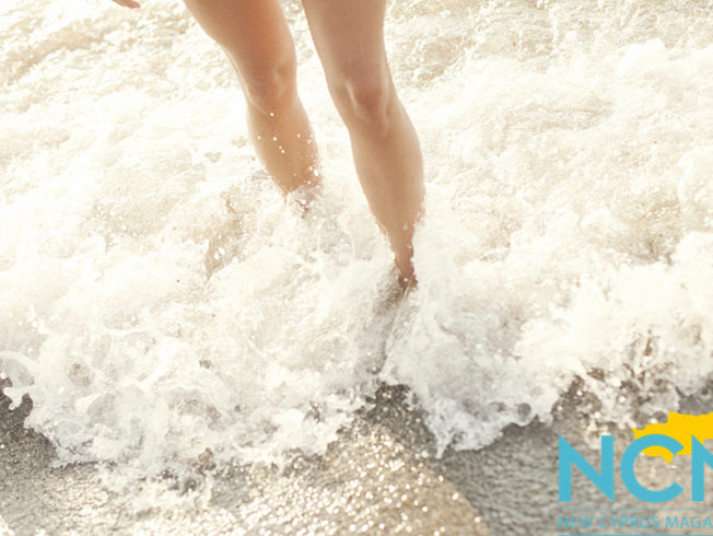 north-cyprus-legs-feet-in-sand-sea-waves