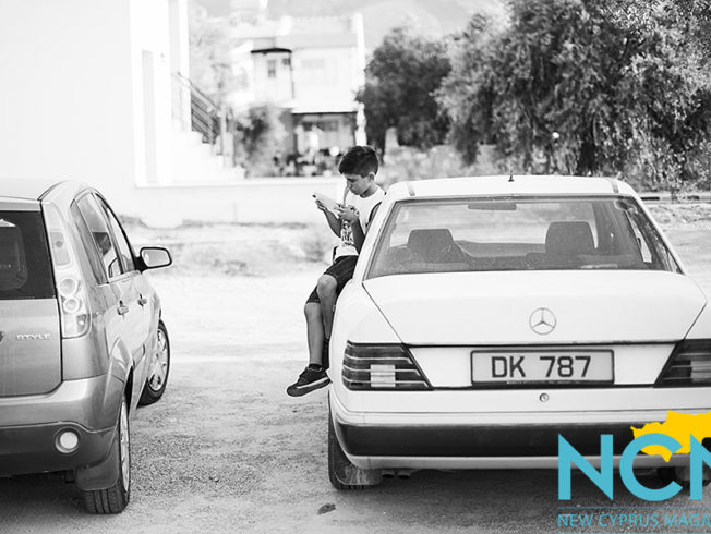 north-cyprus-2015-boy-sitting-on-car