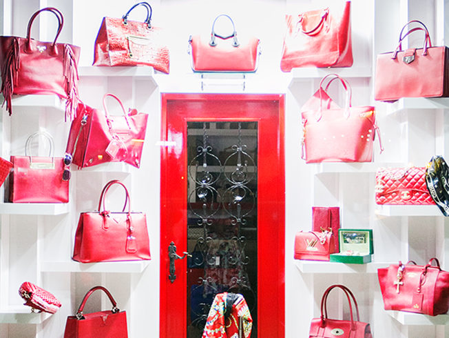 Red handbags and shoes in shopping window in North Cyprus