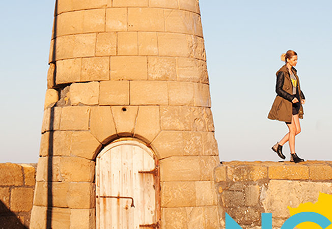 Woman and tower in Girne