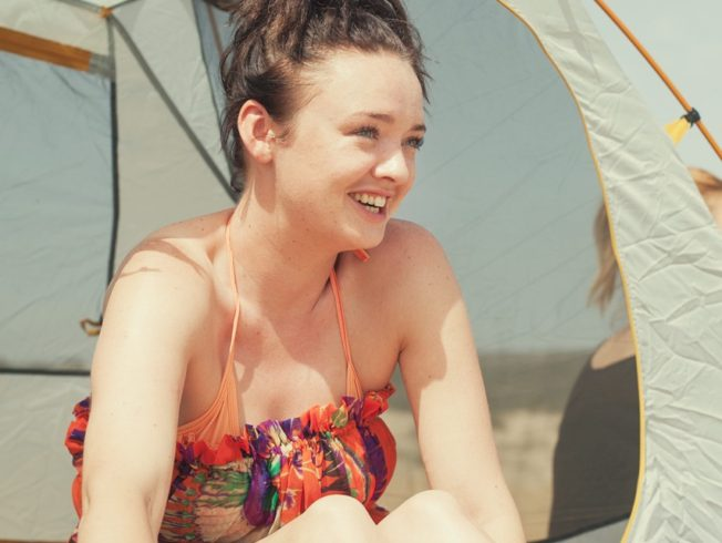 Girl in tent on beach