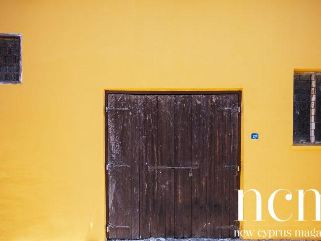 Yellow wall and wooden door
