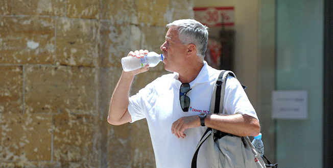 Cyprus summer man drinking water